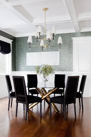 gold dining table with black velvet dining chairs transitional