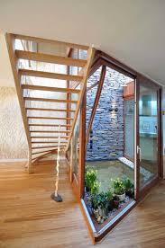 healthy home with indoor garden design understairs with exposed