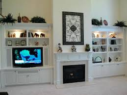 fireplace cabinet ideas elegant white cabinets and shelves with full of decorative items and set modern fireplace cabinet