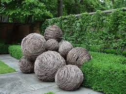 Garden Art To Make - idea to make garden spheres with grapevine and hypertufa slurry
