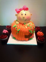 lil baby shower buttercream finished pumpkin with baby girl made out of