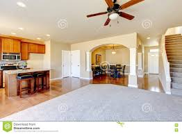 open floor plan view of kitchen dining room and entryway stock