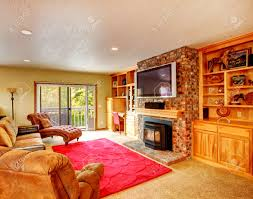 Comfortable Living Room With Storage Combination And Brick Wall