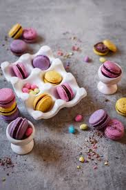 speckled easter egg macarons with chocolate ganache tin