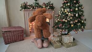 Teddy Bear Christmas Decorations by Young Woman Sitting On The Floor And Hugs Toss Touch A Big Teddy