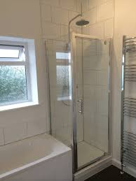 Bathroom With Bath And Shower Shower Enclosure At End Of Bath In A Bathroom Installation By Uk