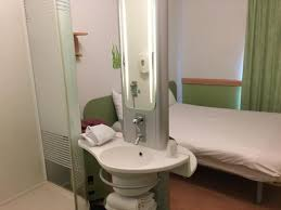Small sink No privacy in shower Great for couple or one person