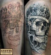 cool cover up skull crown skeleton hand black and grey tattoo