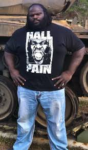 mark henry posing with 765 lbs on bench press bodybuilding com