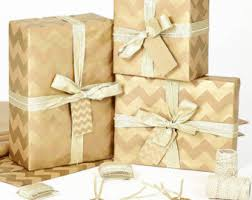 gold gift wrap brown paper gift wrap with gold ribbon and a decorative sticker