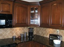 interior kitchen backsplash cherry cabinets black counter with
