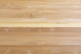 laminated wood table top top view of a large wood laminated table top illuminated with