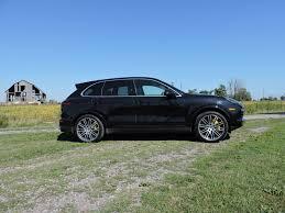 porsche suv black bmw x5 m vs porsche cayenne turbo s vs range rover sport svr