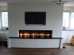 tv en gelhaard in een wand google zoeken fireplaces