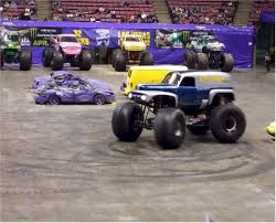 grave digger legend monster truck getting jacked up at the monster jam truck show monsterjam