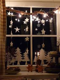 Lighted Christmas Star Display by Simple Christmas Trees And Stars Hanging From A Branch Window