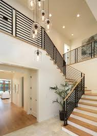 grey hardwood floors with open staircase u0026 steel railings our