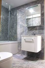 ideas tips for creating stylish over bath showers this stylish but compact bathroom with over bath shower features large stone effect porcelain wall and
