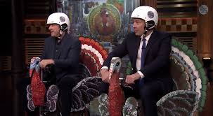 jimmy fallon races tim allen on turkey scooters alert politics