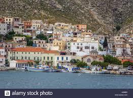 italian style houses and fishing boats pothia kalymnos greece