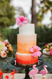 peach ombre wedding cake picture of peach ombre wedding cake topped with blooms