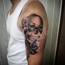 gangsta exposed half skull on left half sleeve