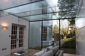 glass box extensions with glass beams supporting the structural