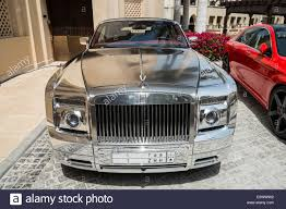 rolls royce chrome chrome plated rolls royce luxury car parked outside hotel in dubai
