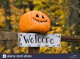funny welcome autumn color and welcome sign with funny jack o lantern on fence
