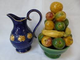 blue and gilt water jug along with a vintage 3d fruit bowl ornament