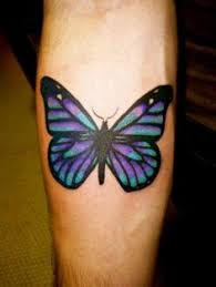 i m against tattoos but this is awesome cross with butterfly