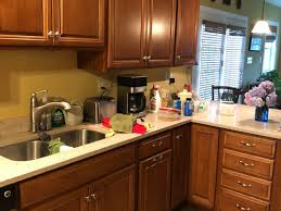 black handles on oak kitchen cabinets what knobs could i use with honey colored wood cabinets