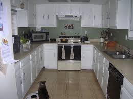 Small Kitchen Design With Peninsula White Cabinets And Marble Countertops Small Kitchen Wall Storage