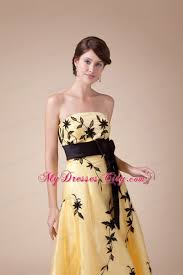 strapless embroidery yellow prom gown with black bowknot
