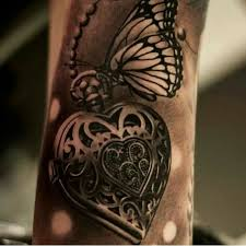 locket and butterfly arm tattoomagz