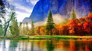 landscape autumn colored trees lake mountagne river green