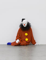 these sad clown sculptures are way too realistic not to feel you