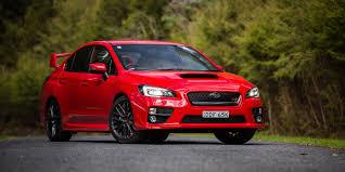 subaru sti 2016 red ford focus rs v subaru wrx sti v volkswagen golf r comparison