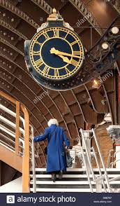 old age home design concepts an old woman under the clock at york railway station concept of