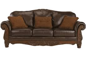 Traditional Leather Sofa With Show Wood Accent By Ashley Furniture - Leather sofas chicago