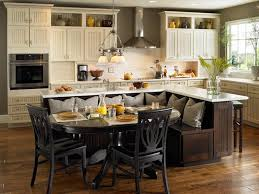 kitchen white wooden kitchen island with shelves and black counter