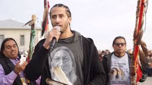 kaepernick shows up at unthanksgiving day event calls