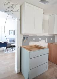 how do you fill the gap between kitchen cabinets and ceiling kitchen cabinet installation centsational style