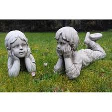 the ornamental with teddy garden statue is for