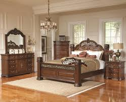 dark brown wooden bed with brown striped bed sheet on mocha rug