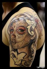colorful dia de los muertos skull with roses tattoo on foot
