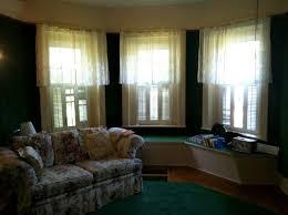 living room with dark green carpet carpet vidalondon