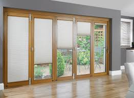 interior brown wooden french door with white roll blind combined