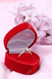 wedding ring in a box gold engagement ring with diamond in a heart shaped box