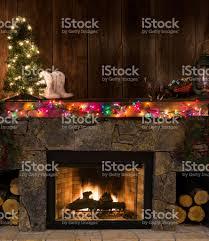 western fireplace wchristmas decorfirebootslighted